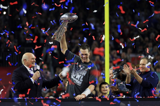 Tom Brady of the New England Patriots holds the Vince Lombardi Trophy after defeating the Atlanta Falcons 34-28 in overtime during Super Bowl 51 at NRG Stadium in Houston on Feb. 5. (Mike Ehrmann/Getty Images)