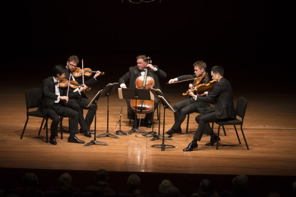(L-R) Violinists Sean Lee and Alexander Sitkovetsky; cellist Keith Robinson; and violists Matthew Lipman and Richard O'Neill perform at Alice Tully Hall. (Tristan Cook.)
