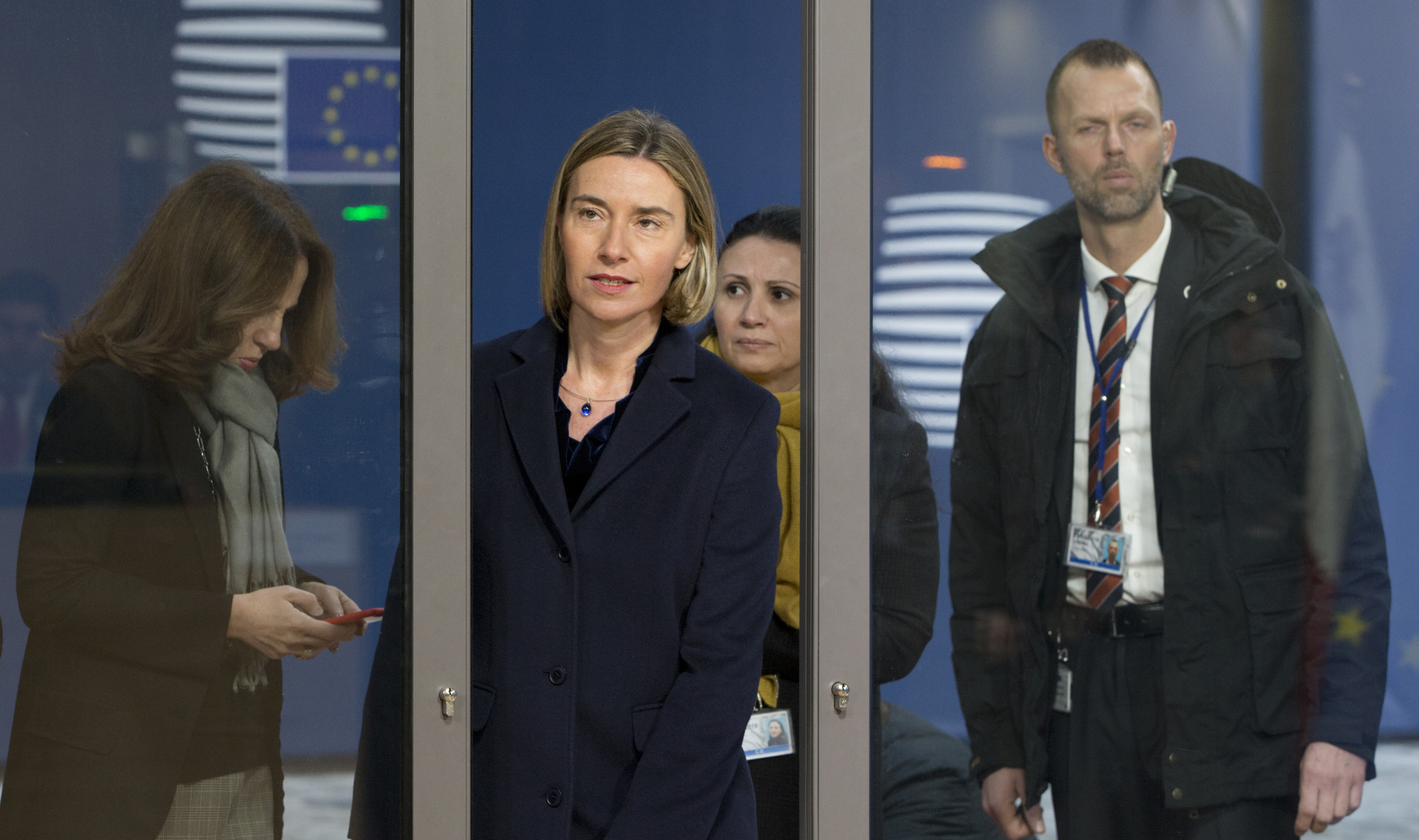 European Union foreign policy chief Federica Mogherini (C) arrives for a meeting of EU foreign ministers at the EU Council building on Feb. 6, 2017. (AP Photo/Virginia Mayo)