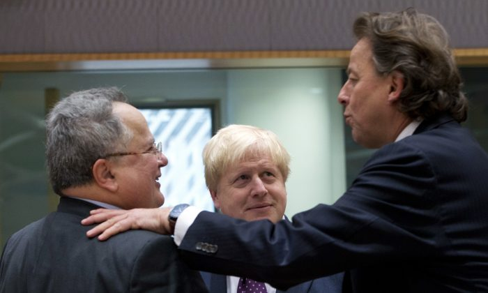 British Foreign Minister Boris Johnson (C) speaks with Greek Foreign Minister Nikos Kotzias (L) and Dutch Foreign Minister Bert Koenders (R) during a meeting of EU foreign ministers at the EU Council building on on Feb. 6, 2017. (AP Photo/Virginia Mayo)