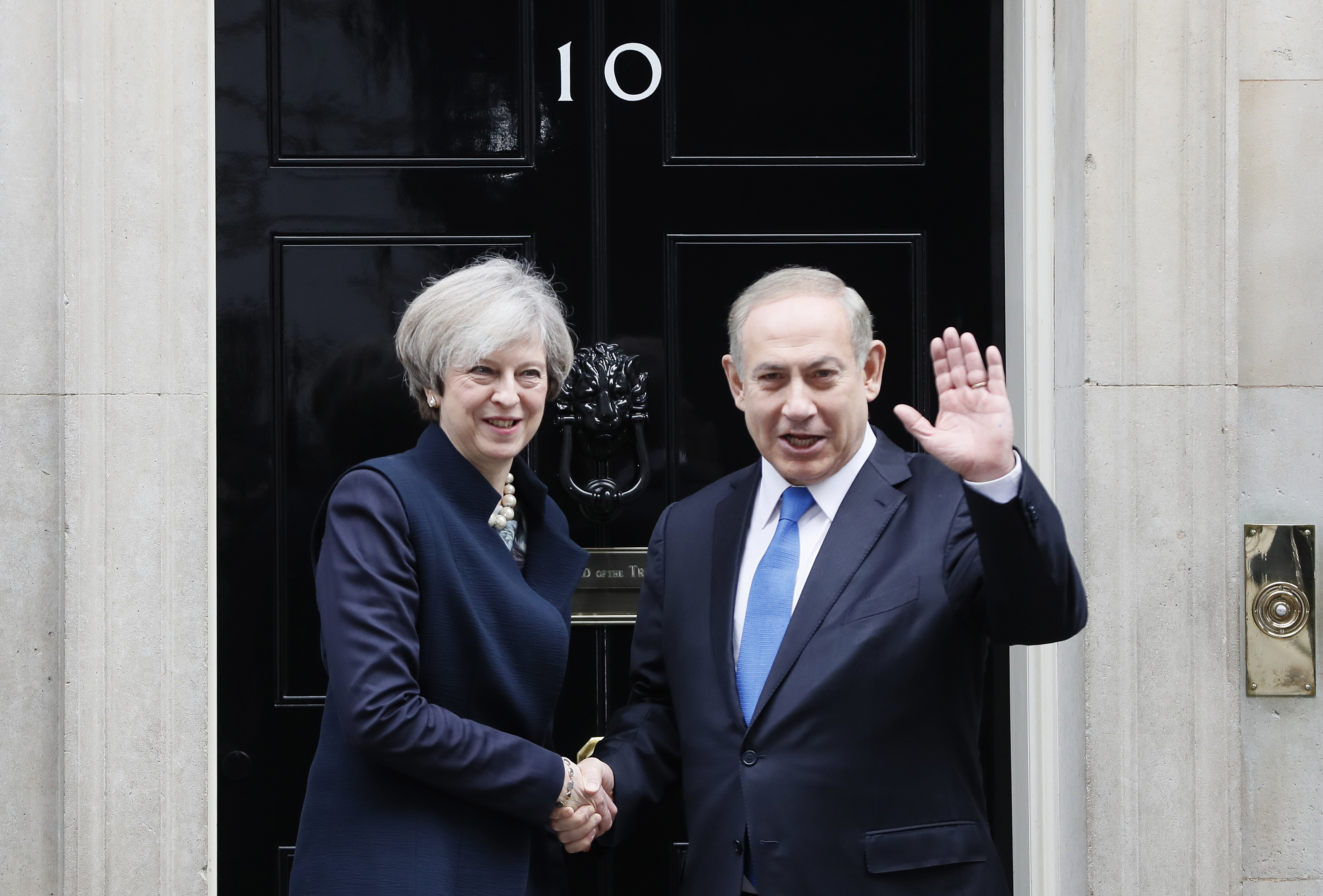 Britain's Prime Minister Theresa May greets Prime Minister Benjamin Netanyahu of Israel at Downing Street in London on Feb. 6, 2017. (AP Photo/Kirsty Wigglesworth)