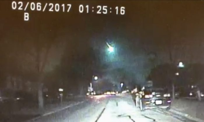 This image from a dashcam video provided by the Lisle Police Department in Lisle, Ill., shows a meteor as it streaked over Lake Michigan on Feb. 6, 2017. (Lisle (Ill.) Police Department via AP)