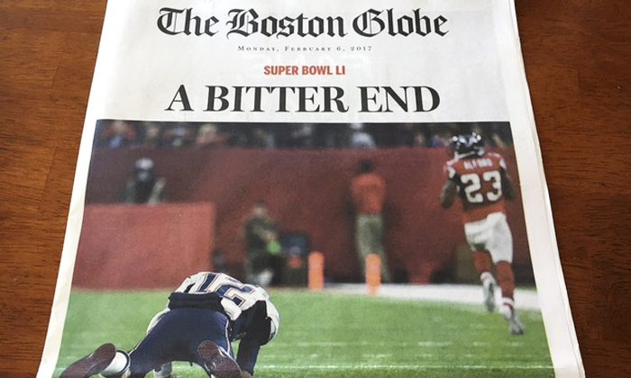 This Monday, Feb. 6, 2017, photo provided by Mary Tivnan shows a front page of an early edition of The Boston Globe in North Fort Myers, Fla. (Mary Tivnan via AP)