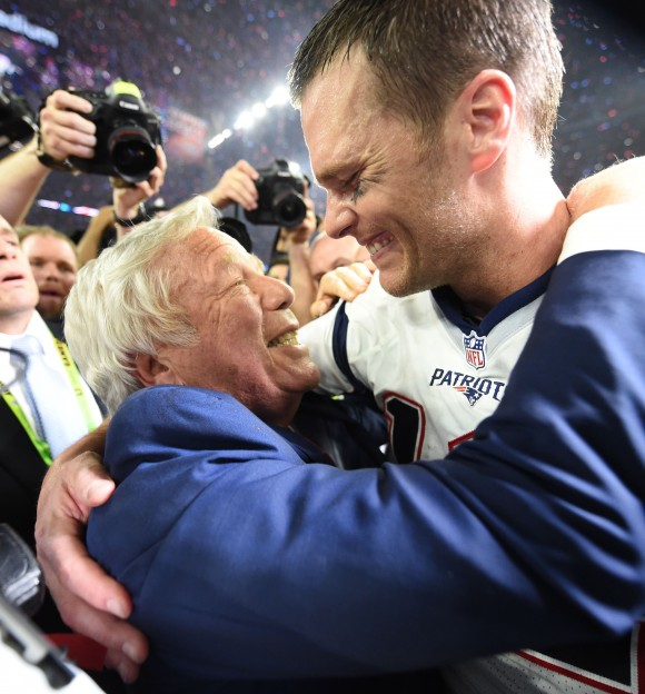 New England Patriots owner Robert Kraft and Tom Brady #12 of the New England Patriots celebrate after defeating the Atlanta Falcons during Super Bowl 51 at NRG Stadium in Houston, Texas on Feb. 5, 2017.  The Patriots defeated the Falcons 34-28 after overtime. (TIMOTHY A. CLARY/AFP/Getty Images)