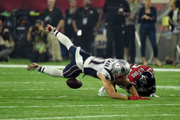 Robert Alford #23 of the Atlanta Falcons tackles Julian Edelman #11 of the New England Patriots in the first quarter of Super Bowl 51 at NRG Stadium in Houston, Texas on Feb. 5, 2017. (TIMOTHY A. CLARY/AFP/Getty Images)