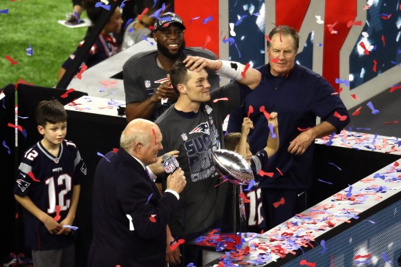 Tom Brady #12 of the New England Patriots celebrates with the Vince Lombardi Trophy after defeating the Atlanta Falcons during Super Bowl 51 at NRG Stadium in Houston, Texas on Feb. 5, 2017. The Patriots defeated the Falcons 34-28. (Ezra Shaw/Getty Images)