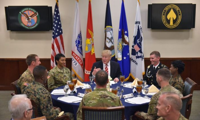 President Donald Trump sits down for lunch with troops during a visit to the US Central Command  at MacDill Air Force Base  in Tampa, Fla., on Feb. 6, 2017. (Mandel Ngan/AFP/Getty Images)
