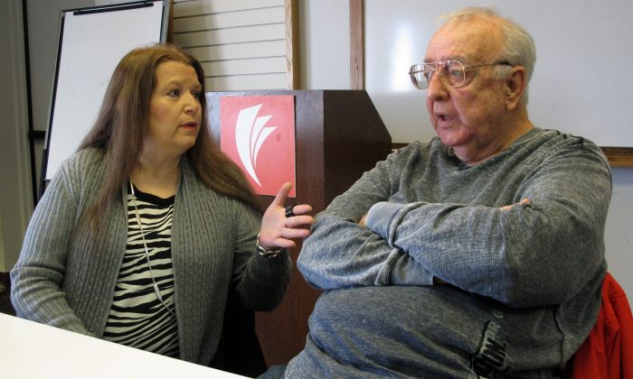 Lori Cooper (L) discusses her efforts to bring to trial the suspect who shot her father, Columbus police officer Niki Cooper, in 1972, as Niki Cooper and partner Bob Stout (R) interrupted a burglary,  in Columbus, Ohio on  Jan. 30, 2017. (AP Photo/Andrew Welsh-Huggins)