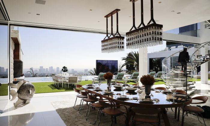 The indoor and outdoor dining areas at a $250 million mansion in the Bel-Air area of Los Angeles. (AP Photo/Jae C. Hong)