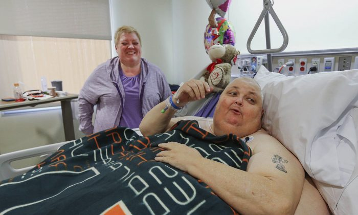Kitty Logan stands by her husband Roger Logan as he rests on a bed at Bakersfield Memorial Hospital two days after he had his 130-pound tumor removed at the hospital in Bakersfield, Calif., on Feb. 2, 2017. (Henry A. Barrios/The Bakersfield Californian via AP)