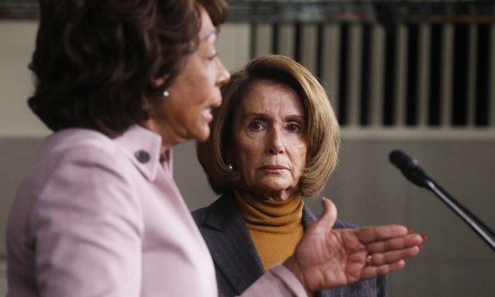 WASHINGTON, DC - FEBRUARY 06:  House Minority Leader Nancy Pelosi (D-CA), C, looks on as U.S. Rep. Maxine Waters (D-CA) speaks at a news conference criticizing President Donald Trump's Wall Street policies on Capitol Hill on February 6, 2017 in Washington, D.C. President Trump is making his first visit to U.S. Central Command and U.S. Special Operations Command today at MacDill Air Force Base in Tampa, Florida.  (Photo by Mario Tama/Getty Images)