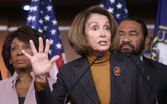 House Minority Leader Nancy Pelosi (D-CA), C speaks as U.S. Rep. Maxine Waters (D-CA) , L, and Rep. Al Green (D-TX) stand at a news conference criticizing President Donald Trump's Wall Street policies on Capitol Hill in Washington on Feb. 6, 2017. (Mario Tama/Getty Images)