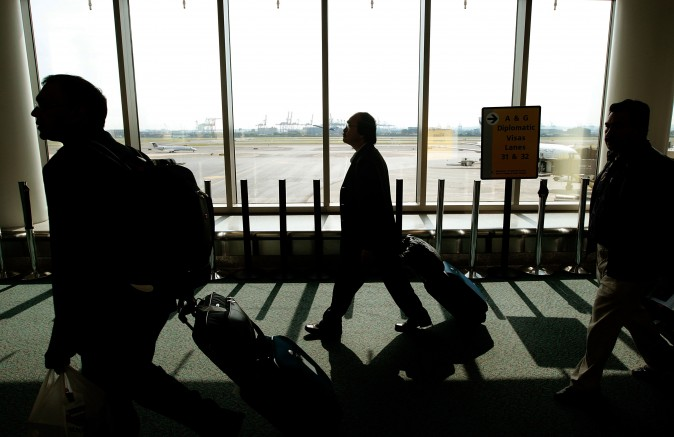 Travelers walk toward the passport control line upon arriving at Newark International Airport in New Jersey in this file photo. (Chris Hondros/Getty Images)
