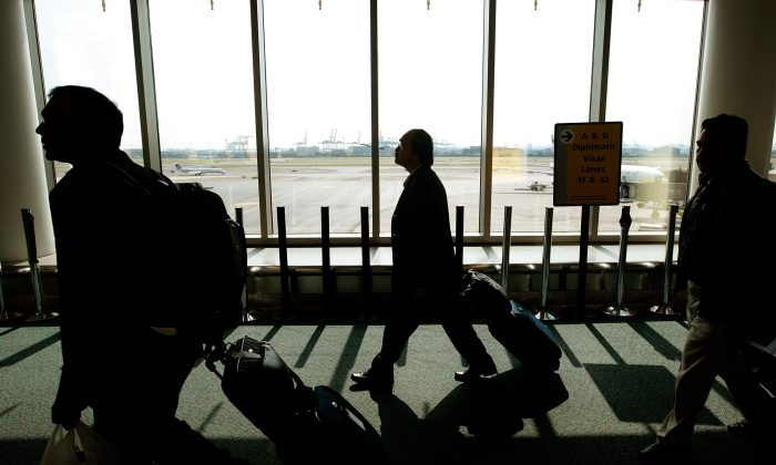 Travels walk toward the passport control line upon arriving at Newark International Airport in New Jersey in this file photo. (Chris Hondros/Getty Images)