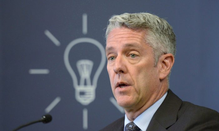 CRTC chairman Jean-Pierre Blais delivers a statement in Gatineau, Que. on May 5, 2015. Some cellphone companies are either passively or actively violating Canada's wireless code of conduct and the rules need to be tightened and enforced, consumer groups say. (The Canadian Press/Adrian Wyld)