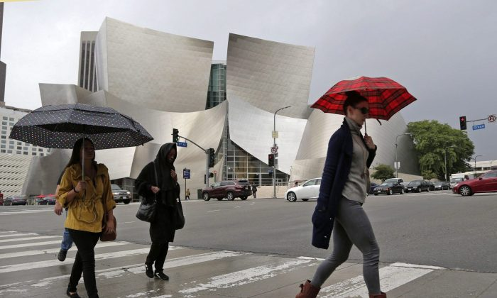 Workers cross the street near Disney Hall in downtown Los Angeles on Oct. 28, 2016. Business immigration lawyer Joseph Grasmick believes there is little for Canadian professionals in the United States to worry about in regards to their TN status if NAFTA is repealed. (AP Photo/Nick Ut)