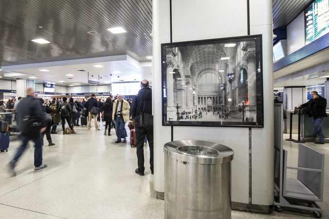 A photo of the original McKim, Mead and White Penn Station on display in the Amtrak concourse of Pennsylvania Station in New York, on Feb. 6, 2017. (Samira Bouaou/Epoch Times)
