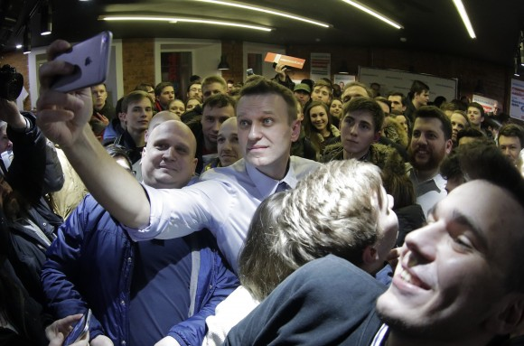 Russian opposition leader Alexei Navalny takes a selfie with his supporters at the opening of his campaign office in St. Petersburg, Russia, on Feb. 4, 2017. (AP Photo/Elena Ignatyeva)
