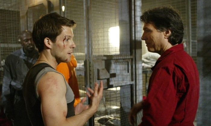 "Actors Jamie Bamber (L) and Richard Hatch talk in between takes during the filming of Sci-fi channel's ""Battlestar Galactica,"" in Surrey, British Columbia on May 19, 2004. (Richard Lam/The Canadian Press via AP)"