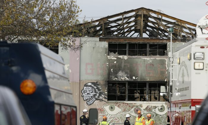 Members of the Alameda County Sheriff's Office stand outside the warehouse called the Ghost Ship, the site of a fire that killed 36 people, in Oakland, Calif. on Dec. 7, 2016. (AP Photo/Eric Risberg,File)