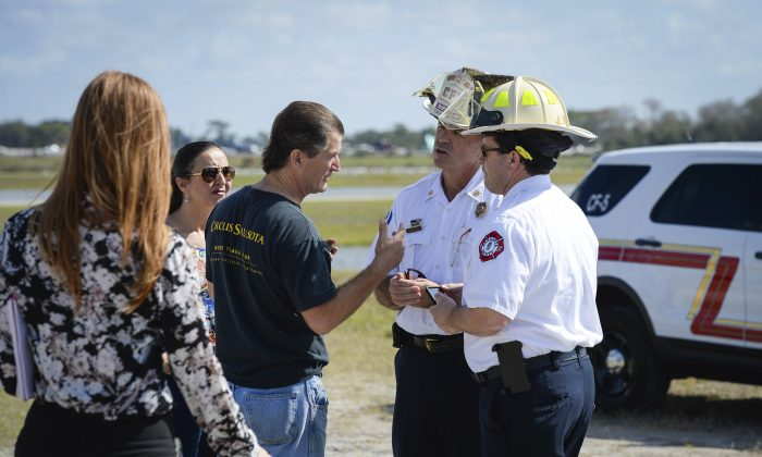 Pedro Reis, founder and CEO of the Circus Arts Conservatory, speaks with the Sarasota Fire Department prior to a press conference in Sarasota, Fla., on Feb. 8, 2017. (Rachel S. O'Hara/Sarasota Herald-Tribune via AP)