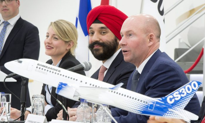 Bombardierpresident and CEO Alain Bellemare ® responds to a question as Heritage Minister Melanie Joly (L) and Innovation Minister Navdeep Bains watch on Feb. 7 in Montreal. (The Canadian Press/Paul Chiasson)