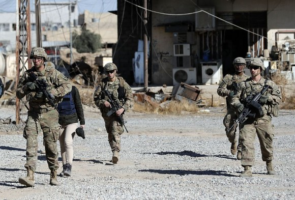 US soldiers patrol near an Iraqi army base on the outskirts of Mosul, on November 23, 2016.  (THOMAS COEX/AFP/Getty Images)