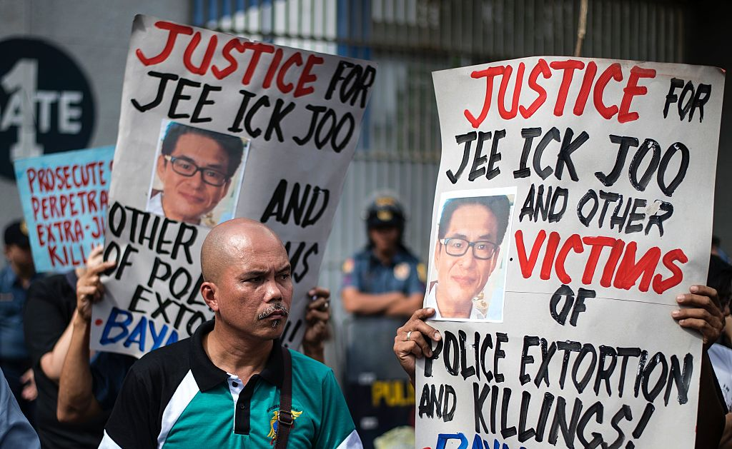 Activists hold a protest in front of Camp Crame, the headquarters of the Philippine National Police (PNP), carrying mock dead bodies, condemning the government's War on Drugs and holding placards showing the picture of the late South Korean businessman Jee Ick-Joo, who was murdered allegedly by suspected policemen in Manila on January 27, 2017. (NOEL CELIS/AFP/Getty Images)