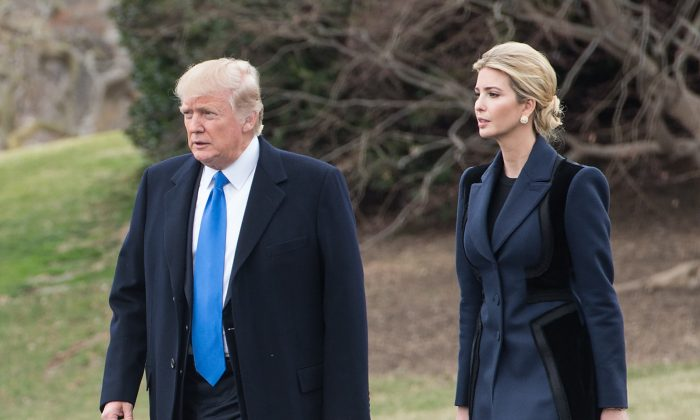 US President Donald Trump and his daughter Ivanka walk to board Marine One at the White House in Washington, DC, on Feb. 1, 2017. (NICHOLAS KAMM/AFP/Getty Images)