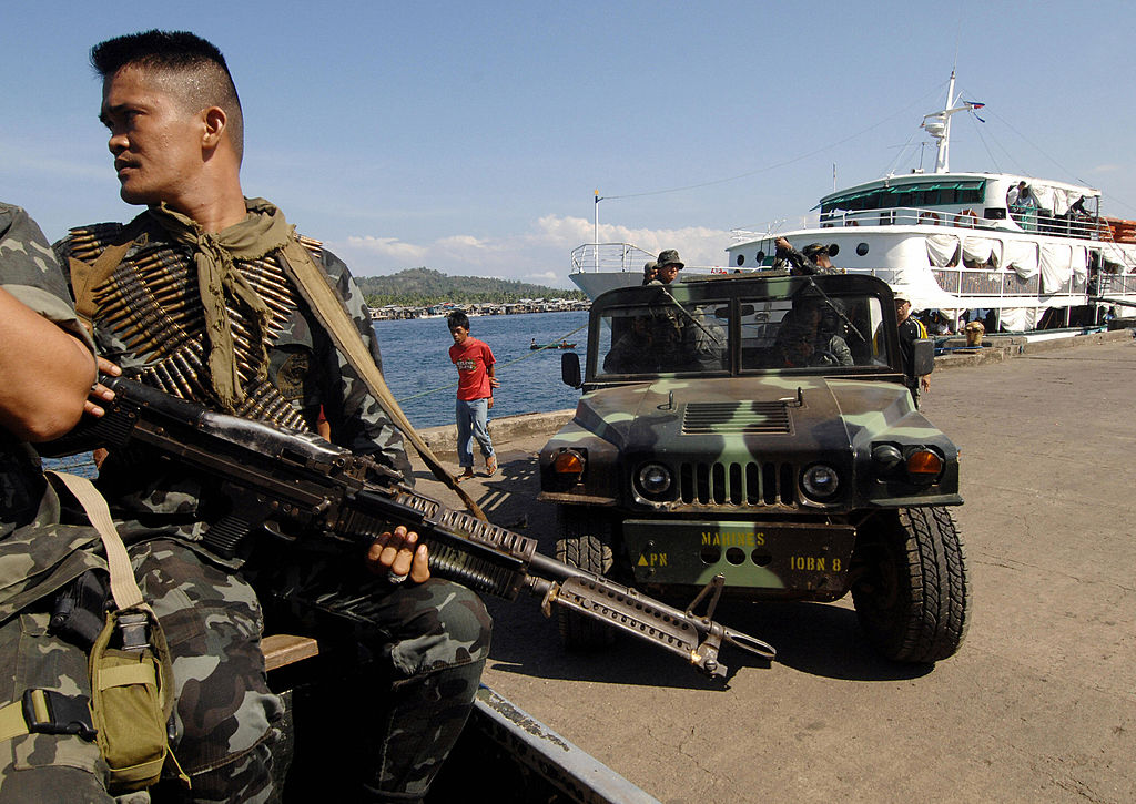 Soldiers patrol along the wharf in Basilan island during an anti-kidnap operation on Feb. 18, 2009. (THERENCE KOH/AFP/Getty Images)