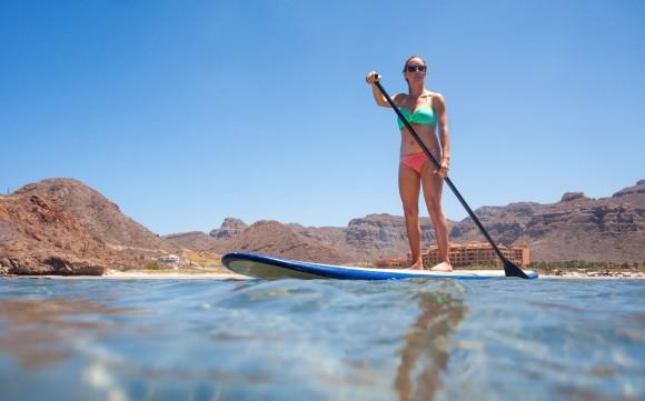 Standup paddleboarding near the Villa del Palmar. (Villa del Palmar Beach Resorts & Spa)