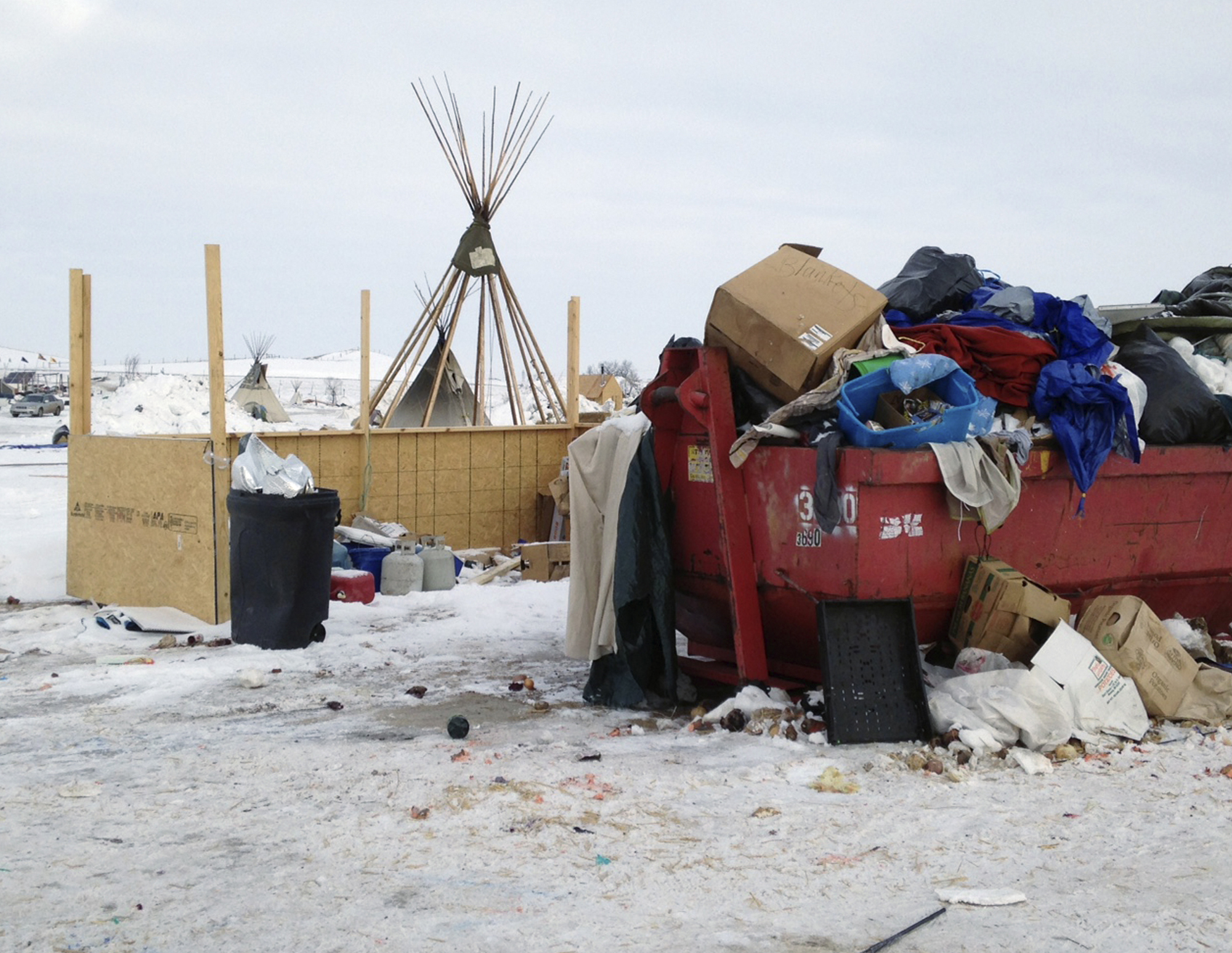 Trash is seen piled in a dumpster at an encampment set up near Cannon Ball, N.D., on Feb. 8, 2017, for opponents against the construction of the Dakota Access pipeline. (AP Photo/James MacPherson)