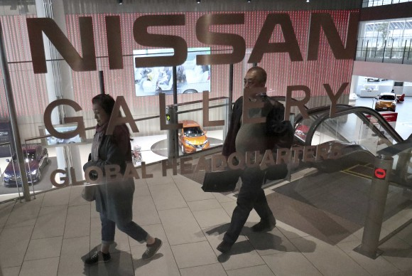 Visitors walk around a gallery of the Nissan Motor Co. at its global headquarters in Yokohama, near Tokyo, on Feb. 9, 2017. (AP Photo/Shizuo Kambayashi)
