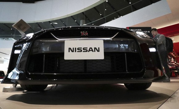A visitor looks at a Nissan GT-R on display at the gallery of its global headquarters in Yokohama, near Tokyo, on Feb. 9, 2017. (AP Photo/Shizuo Kambayashi)