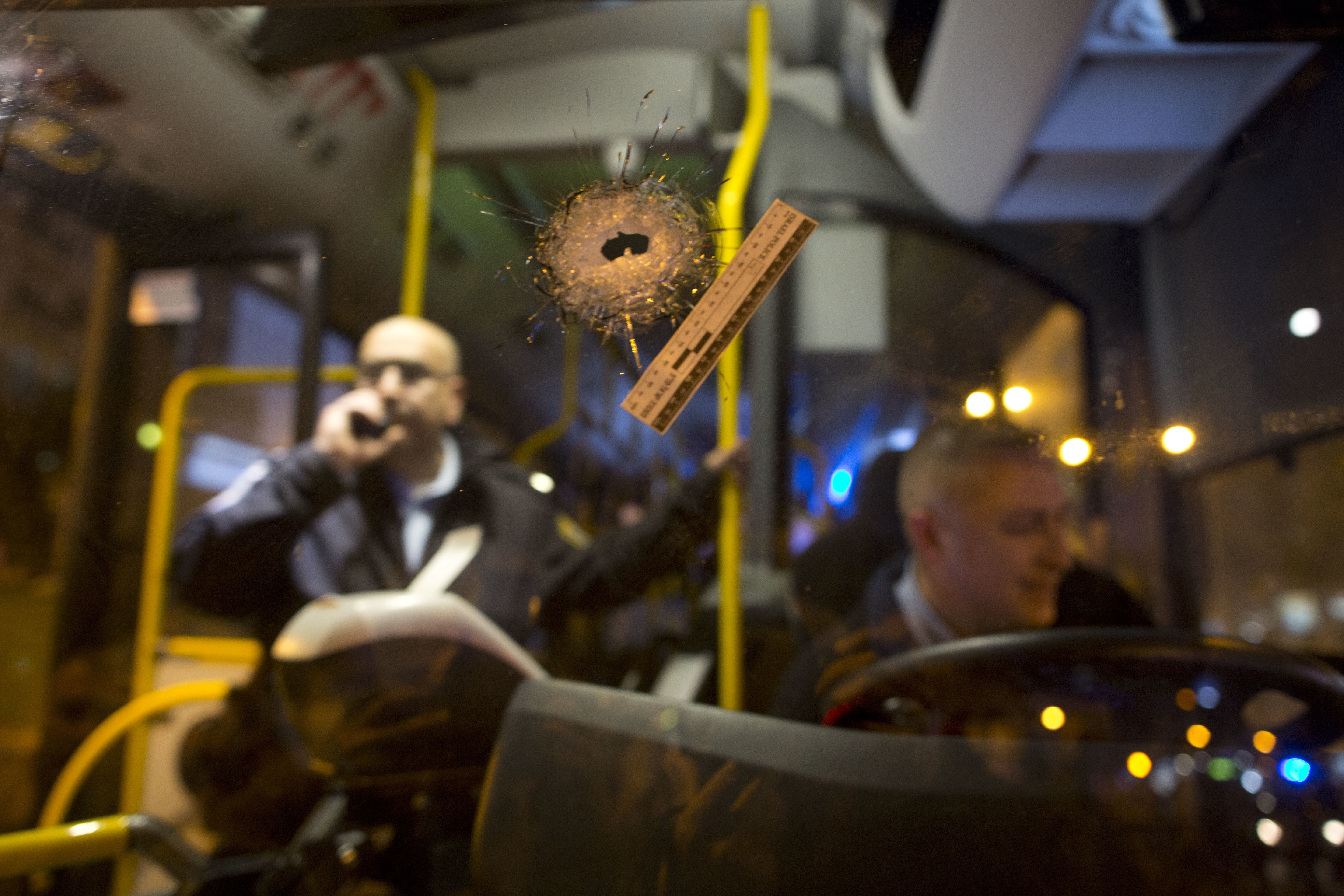 A bullet hole is seen on the windshield of a bus at the scene of a shooting attack in Petah Tikva, Israel on Feb. 9, 2017. (AP Photo/Oded Balilty)