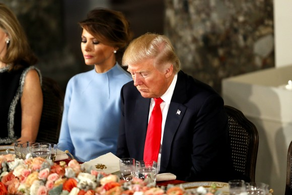President Donald Trump and first lady Melania Trump bow their heads in prayer during the Inaugural Luncheon in the US Capitol in Washington on Jan. 20, 2017. President Trump is attending the luncheon along with other dignitaries after being sworn in as the 45th President of the United States. (Aaron P. Bernstein/Getty Images)