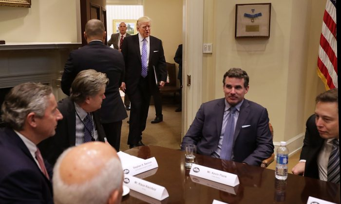 President Donald Trump walks into the Roosevelt Room for a meeting with business leaders, including Under Armour CEO Kevin Plank (2nd-R), at the White House on Jan. 23, 2017. (Chip Somodevilla/Getty Images)