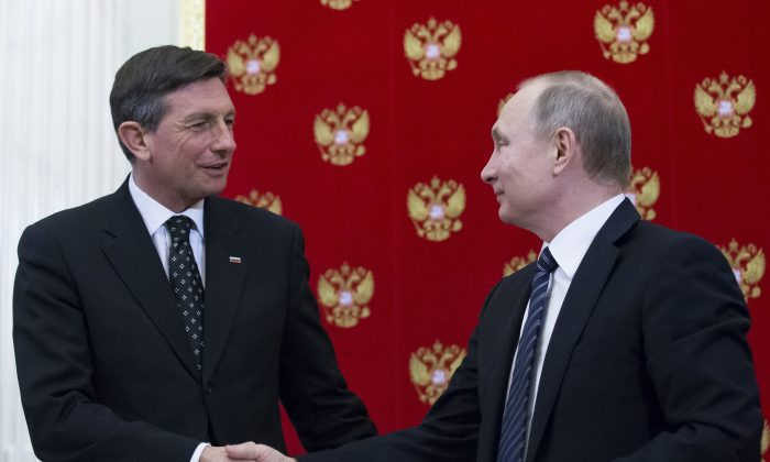 Russian President Vladimir Putin (R) shakes hands with Slovenian President Borut Pahor after a signing ceremony following their talks at the Kremlin in Moscow, Russia on Feb. 10, 2017. (AP Photo/Alexander Zemlianichenko, pool)