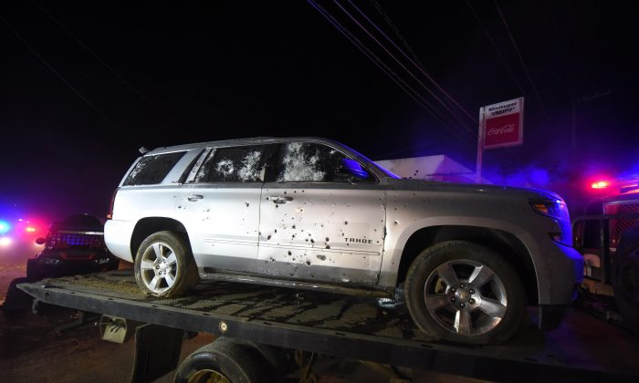 A bullet ridden sports utility vehicle is taken away by authorities after a gun battle with Mexican Marines in which a suspect identified by authorities as the leader of the Beltran Leyva cartel, Juan Francisco Patron Sanchez and several accomplices died in the exchange, in Tepic, Nayarit state, Mexico on Feb. 10, 2017. (AP Photo/Chris Arias)