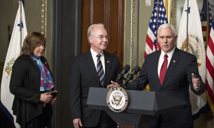 Health and Human Services Secretary Tom Price, center, and his wife Betty listen as Vice President Mike Pence speaks in the Eisenhower Executive Office Building on the White House complex in Washington, Friday, Feb. 10, 2017, after Pence administered the oath of office to Price. (AP Photo/Andrew Harnik)
