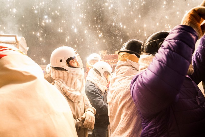 People get sprayed by fire sparks during the annual Yanshui Beehive Rockets Festival, ranked as the fifth most dangerous festival in the world, in Tainan City, Taiwan, on Feb. 10, 2017. Participants are geared up with motorcycle helmets, fire-retardant clothing and thick gloves, with hundreds of thousands of firecrackers going off at the same time. (Billy H.C. Kwok/Getty Images)