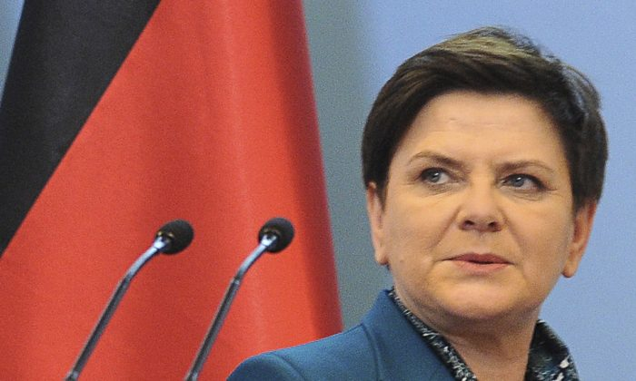 Polish Prime Minister Beata Szydlo arrives at a press conference on In this Tuesday Feb. 7, 2017. (AP Photo/Alik Keplicz )