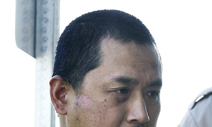 File- This Aug. 5, 2008, file photo shows Vince Li. Li, who was found not criminally responsible for beheading and cannibalizing a fellow passenger on a Greyhound bus has been granted his freedom. (John Woods/The Canadian Press via AP, File)