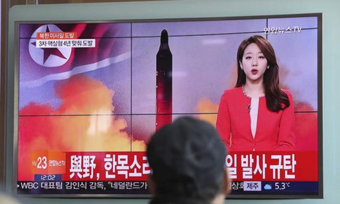 "A man watches a TV news program reporting about North Korea's missile launch with a file image of a North Korean missile at the Seoul Train Station in Seoul, South Korea, Sunday, Feb. 12, 2017. North Korea reportedly fired a ballistic missile early Sunday in what would be its first such test of the year and an implicit challenge to President Donald Trump's new administration. Details of the launch, including the type of missile, were scant. The letters read ""The ruling and the opposition parties denounce North Korea's missile launch."" (AP Photo/Lee Jin-man)"