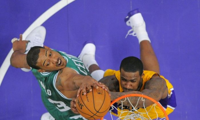 In this Feb. 20, 2013, file pohoto, Boston Celtics center Fab Melo, left, of Brazil, and Los Angeles Lakers forward Earl Clark  . (AP Photo/Mark J. Terrill, File)