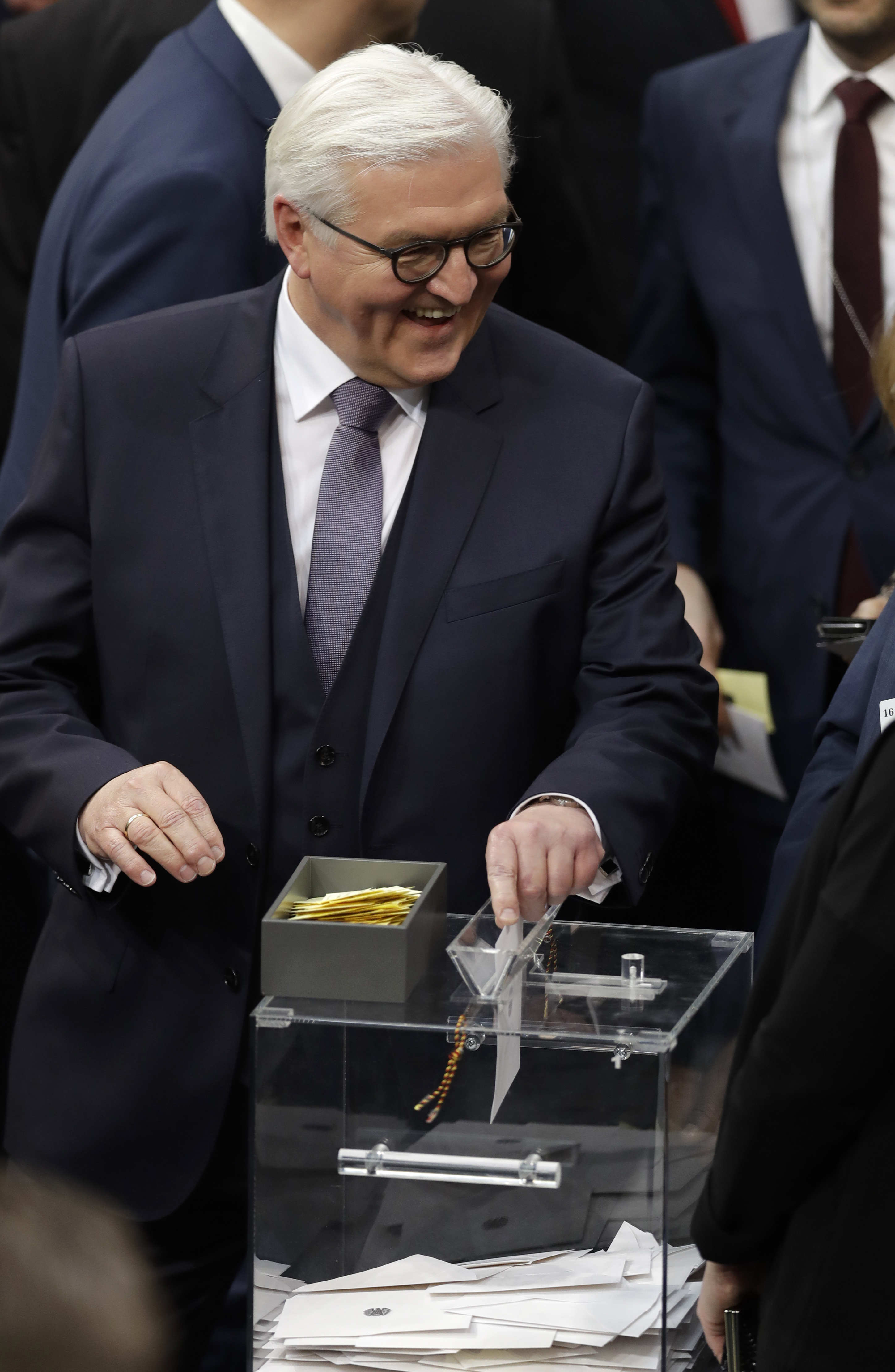 German presidential candidate Frank-Walter Steinmeier casts his ballot when a German parliamentary assembly came together to elect the country's new president in Berlin, Germany on Feb. 12, 2017. (AP Photo/Michael Sohn)