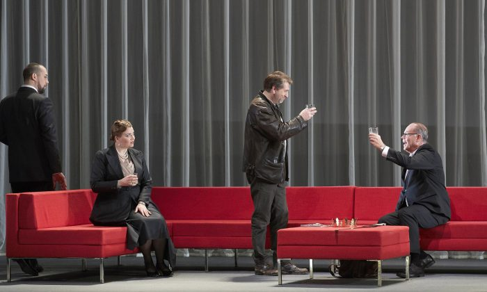 """(L-R) Ain Anger as Hagen, Ileana Montalbetti as Gutrune, Andreas Schager as Siegfried, and Martin Gantner as Gunther in the Canadian Opera Company's 2017 production of """"Götterdämmerung."""" Director Tim Albery has set the epic story in the corporate world to better resonate with modern audiences.(Michael Cooper)"""