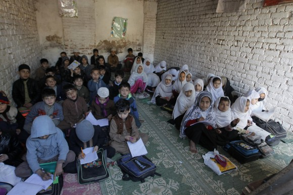 Afghan refugee children study at a school in Peshawar, Pakistan, on Feb. 9, 2017. (AP Photo/Mohammad Sajjad)