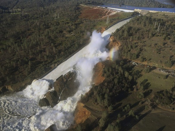 The damaged spillway with eroded hillside in Oroville, Calif., on Feb. 11, 2017. (William Croyle/California Department of Water Resources via AP)