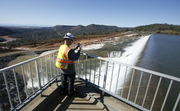 Water going over the emergency spillway at Oroville Dam in Oroville, Calif., on Feb. 11, 2017. (AP Photo/Rich Pedroncelli)